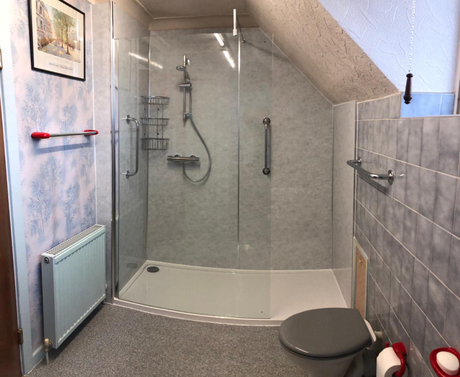 New bathroom installation in Moor Allerton, Leeds with a walk in shower and glass panelling