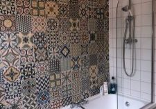 Bathroom fitting including a bath shower and Tiling